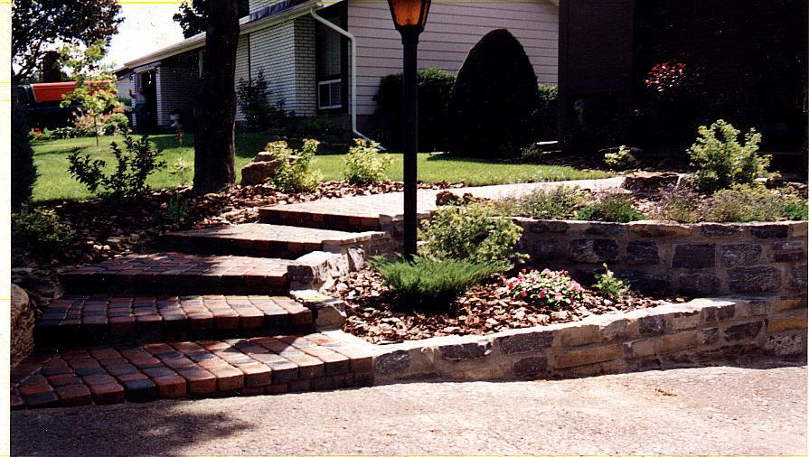Natural wall with pavestone walk